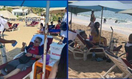 En playas abarrotadas de Acapulco, captan a turista conectado a tanque de oxígeno